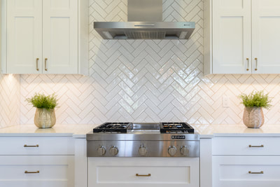 Interior Kitchen tile backsplash with herringbone design in Custom home in Bend, Oregon Northwest Crossing built by Structure Development NW an award winning homebuilder in Central Oregon. Farmhouse Style home with stunning interior design.