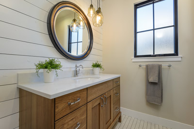 Interior guest bath with white shiplap wall treatment in Custom home in Bend, Oregon Northwest Crossing built by Structure Development NW an award winning homebuilder in Central Oregon. Farmhouse Style home with stunning interior design.