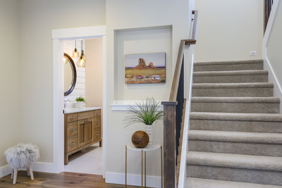 Interior entry foyer and stairs in Custom home in Bend, Oregon Northwest Crossing built by Structure Development NW an award winning homebuilder in Central Oregon. Farmhouse Style home with stunning interior design.