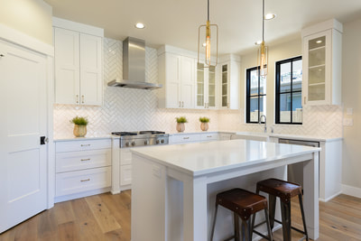 Interior Kitchen with all white cabinetry, countertops, and tile in Custom home in Bend, Oregon Northwest Crossing built by Structure Development NW an award winning homebuilder in Central Oregon. Farmhouse Style home with stunning interior design.